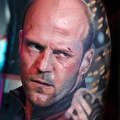 realistic portrait tattoo of Jason Statham