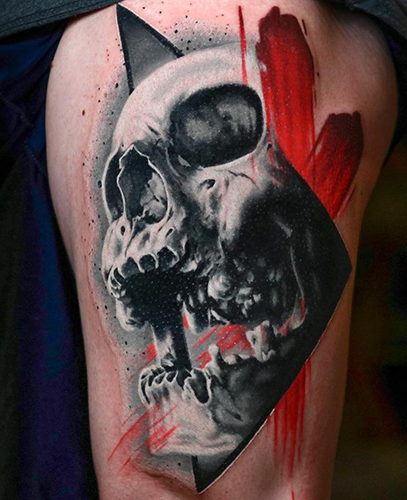 realistic black and grey skull tattoo with red details