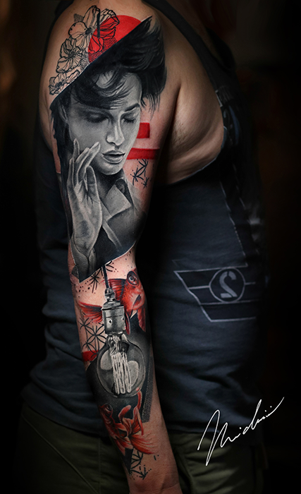 tattoo arm sleeve featuring a singer and red flowers