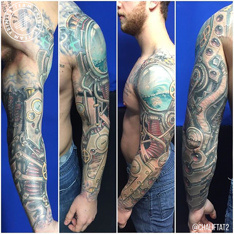 mechanical looking tattoo arm sleeve
