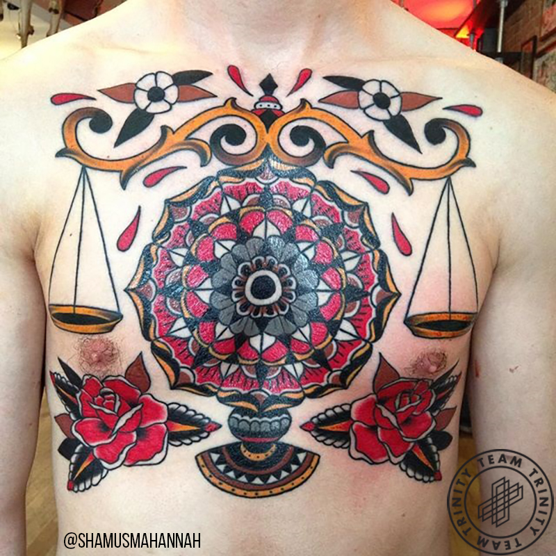 tattoo of scales on a chest